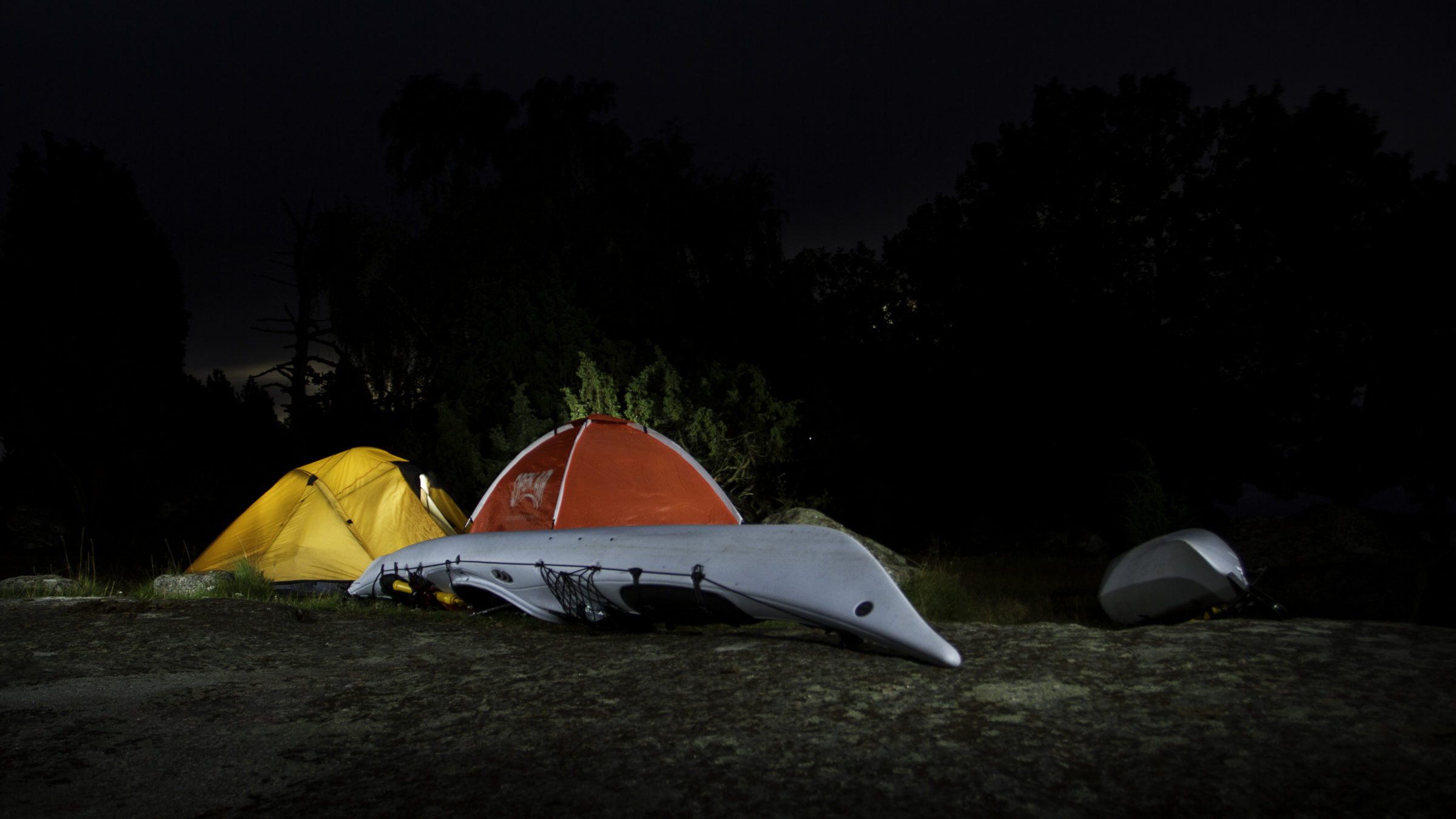 Camp tents set up in the Long Island Pine Barrens at night