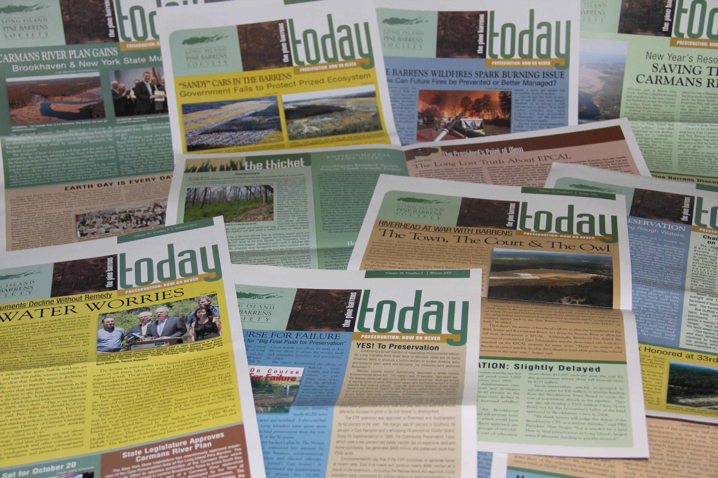 Stack of print copies of the newsletter The Pine Barrens Today