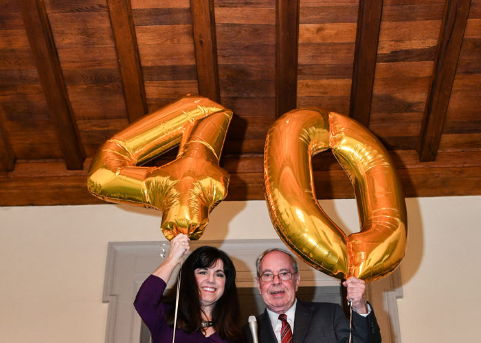 Dick Amper and Kathy Nasta holding a 4 and a 0 balloon