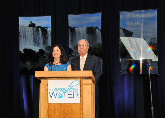 Dick Amper and Kathy Nasta standing at a podium at the Pine Barrens Society Gala