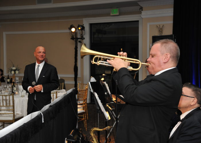 Saxophone player part of a live band at the Pine Barrens Society Gala