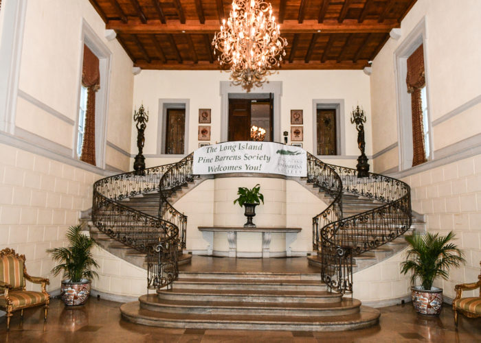 Grand interior staircase of Oheka Castle
