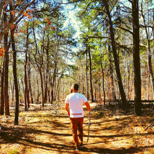 Man hiking on a trail in the Long Island Pine Barrens