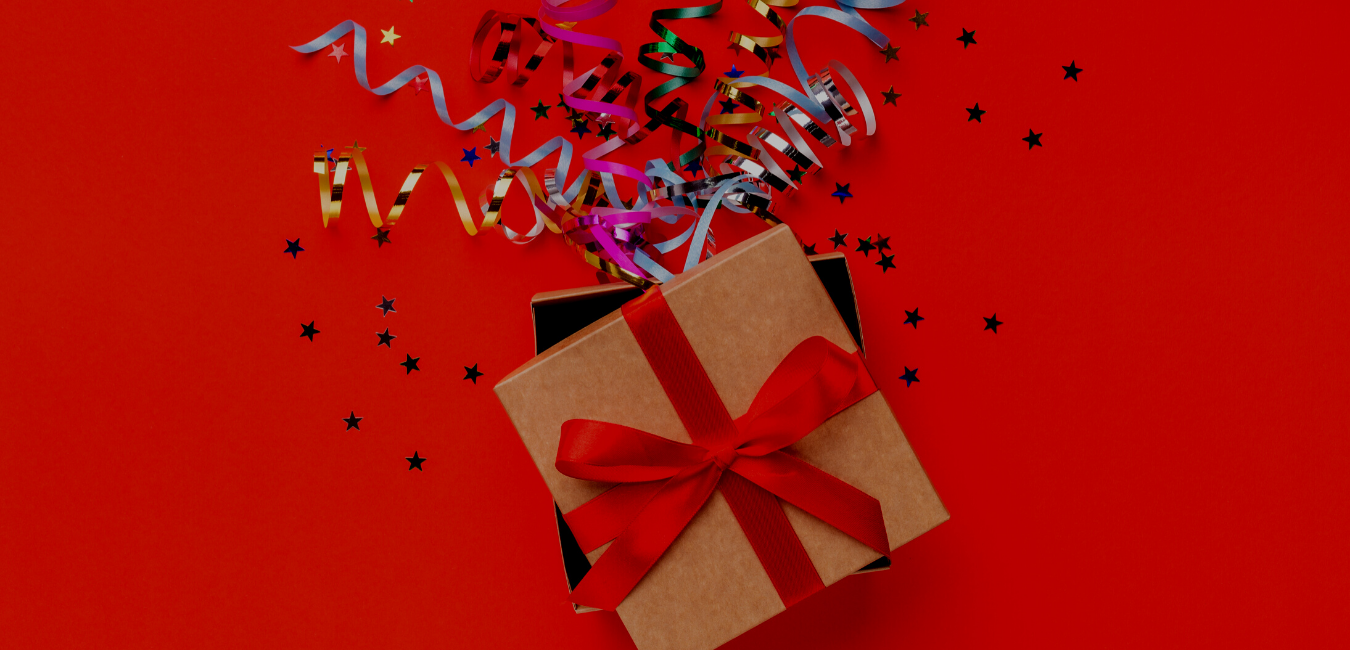 gift box with streamers coming out